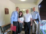 Nick Myerhoff and Link Corkery presenting Ipad 2 gift to clients